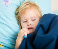 A sick girl is measuring the temperature Royalty Free Stock Photo