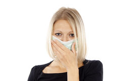 Sick girl in a medical mask Stock Photo