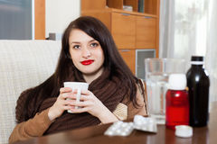 Sick girl with medications Stock Photos