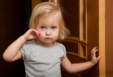 A sick girl is near the door Royalty Free Stock Photography