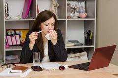 Sick girl in the office Stock Photos