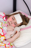 Sick girl sleeping Royalty Free Stock Images