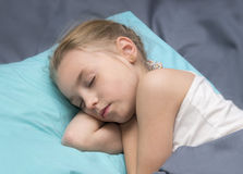 Sick girl is sleeping. In her bed stock photography