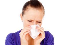 The sick girl sneezes Stock Photo