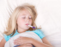 Sick girl with a thermometer in mouth Stock Photos