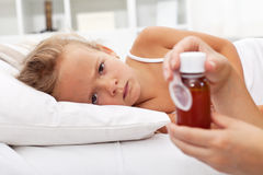 Sick girl waiting for medication Royalty Free Stock Photos