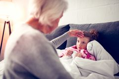 Granddaughter feeling sick after eating too much ice cream stock images