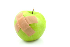 Sick green apple with patches Stock Image