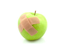 Sick green apple with patches Stock Photos