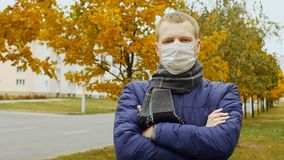 Sick or healthy man wearing surgical procedure mask due to Influenza flu virus