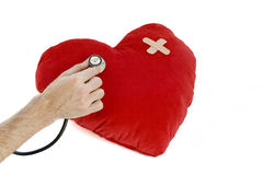 Sick heart. Hand with stethoscope checking a heart Stock Photo