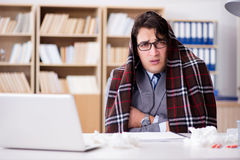 The sick ill businessman in the office Stock Image