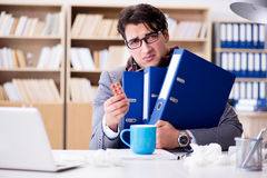 The sick ill businessman in the office Stock Photography