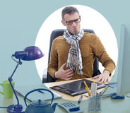 Sick independent man suffering from painful stomach ache at office. Sick middle aged male entrepreneur or independent man suffering from painful stomach ache at Royalty Free Stock Images