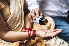 Indian people taking medicines royalty free stock photo