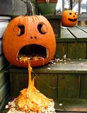 Sick Jack O Lantern. A carved pumpkin on the steps waits to scare the kids on Halloween royalty free stock images