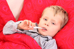 Sick kid. 3-4 years old preschooler in bed - sick Royalty Free Stock Image