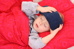 Sick kid. 3-4 years old preschooler in bed - sick Royalty Free Stock Photos