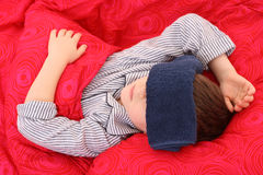 Sick kid. 5-6 years old preschooler in bed - sick Royalty Free Stock Photos
