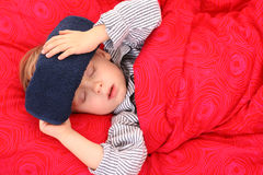 Sick kid. 3-4 years old preschooler in bed - sick Stock Photo