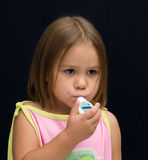 Sick Kid. A sick kid with a thermometer in her mouth Stock Photos