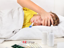 Sick Kid in the Bed Royalty Free Stock Photography