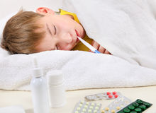 Sick Kid in the Bed Stock Photo