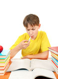 Sick Kid with a Books. Sick Schoolboy with Thermometer and Books on the White Background Stock Image