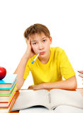 Sick Kid with a Books. Sick Schoolboy with Thermometer and Books on the White Background Stock Photo
