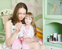 Sick kid with high fever and mother. Taking temperature Stock Photo