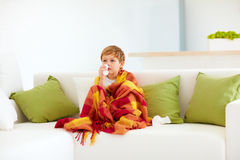 Sick kid with runny nose and fever heat at home Stock Photos