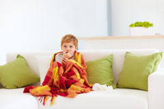 Sick kid with runny nose and fever heat at home Stock Photo