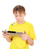 Sick Kid with Tablet. Sick Kid with Thermometer and Tablet Computer on the White Background stock photo