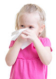 Sick kid wiping or cleaning nose with tissue Stock Photography