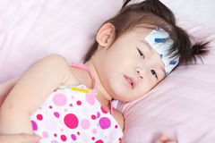 Sick little asian girl Stock Photos