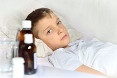 Sick little boy in the bed Royalty Free Stock Photography