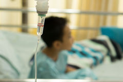 A sick Little boy in hospital bed. Stock Photo
