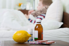 Sick little boy lying in bed Royalty Free Stock Photo