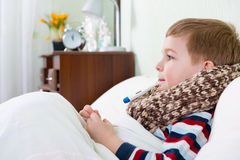 Sick little boy Stock Image