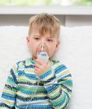Sick little boy makes inhalation home Royalty Free Stock Image