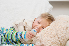 Sick little boy makes inhalation home Royalty Free Stock Photos