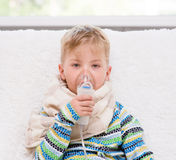 Sick little boy makes inhalation home Royalty Free Stock Image
