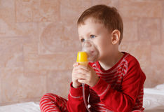 Sick little boy makes inhalation mask for breathing at home Royalty Free Stock Image