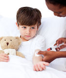 Sick little boy receiving an injection Stock Image