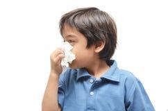 Sick little boy with tissue on white Royalty Free Stock Photos