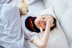Sick little child with temperature Stock Images