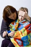 Sick little girl. Sick litle girl on her mother knees Stock Images