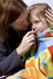 Sick little girl. Sick litle girl on her mother knees Stock Photo