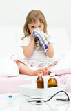 Sick little girl Stock Image