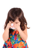 Sick little girl. Little three year old girl having the sniffles or sneezing from being sick or allergies Royalty Free Stock Image